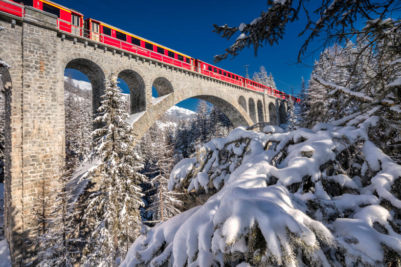 Travel Associates bernina express on bridge in snow