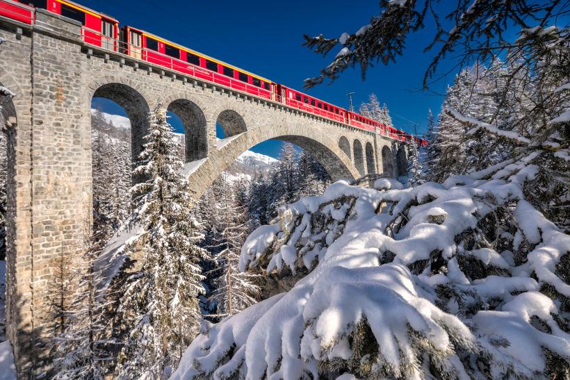 Travel Associates bernina express on bridge in snow