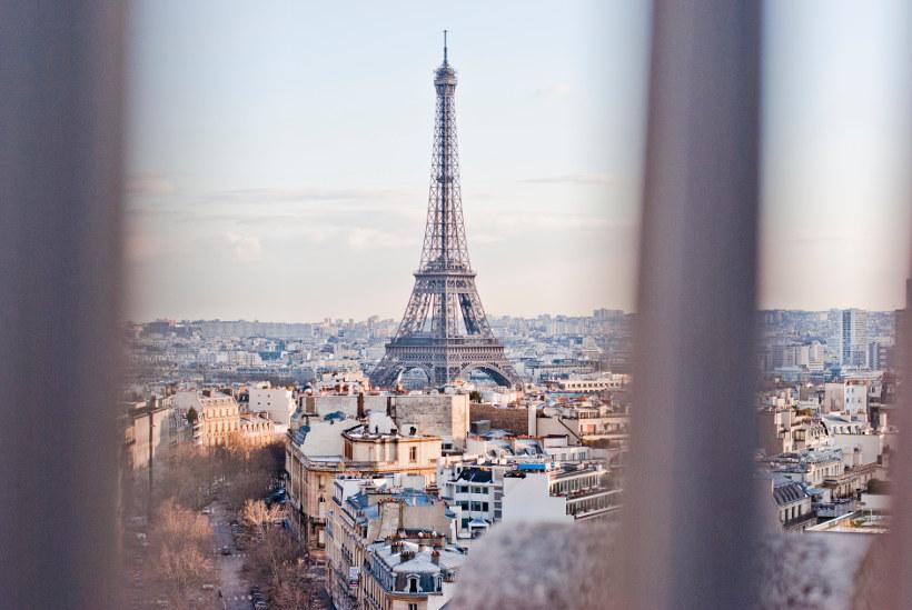 Travel Associates view of Eiffel Tower through window