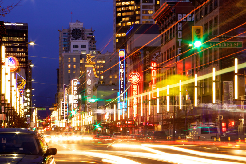 Granville Street in Vancouver at night, with bright lights and blurred traffic