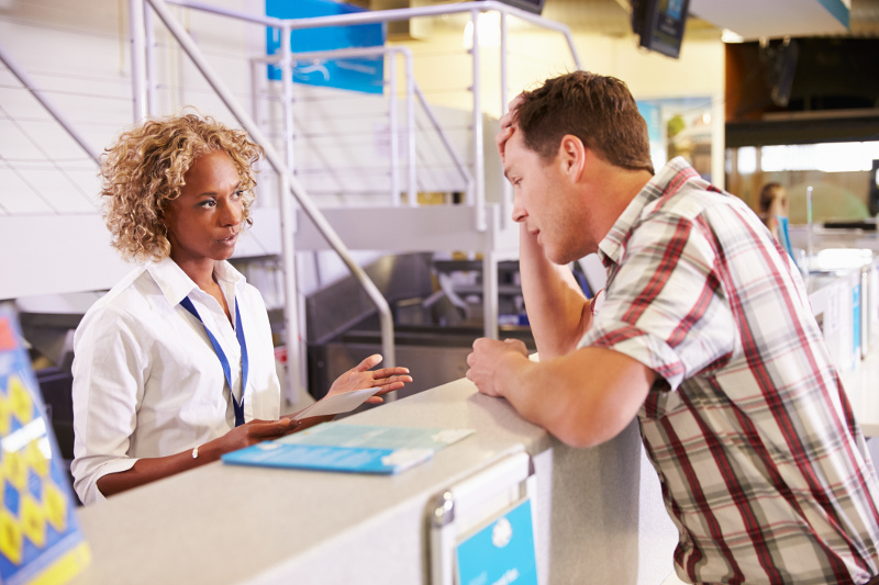 Stressed out guest talks to travel agent