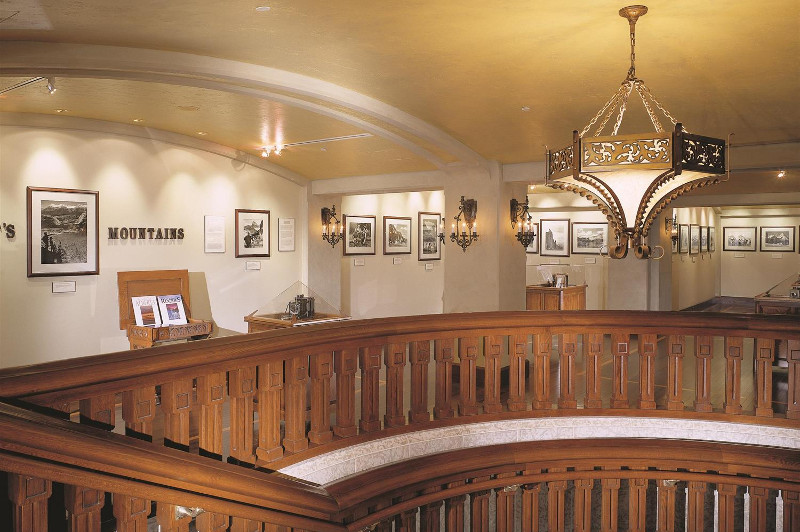 Hall way with photos and staircase in Banff Springs Hotel