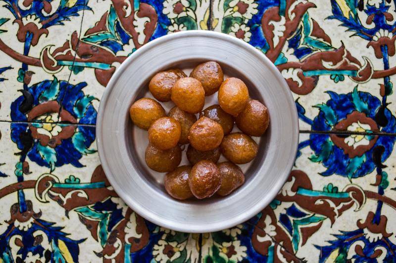 Delicious loukoumades - dense doughnut balls dipped in honey