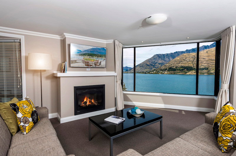 apartment interior with view of lake behind queenstown