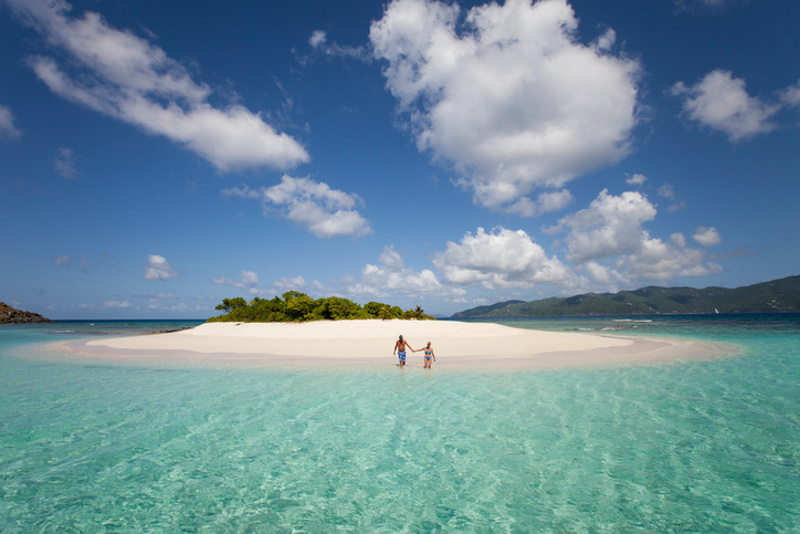 Couple swims at private island