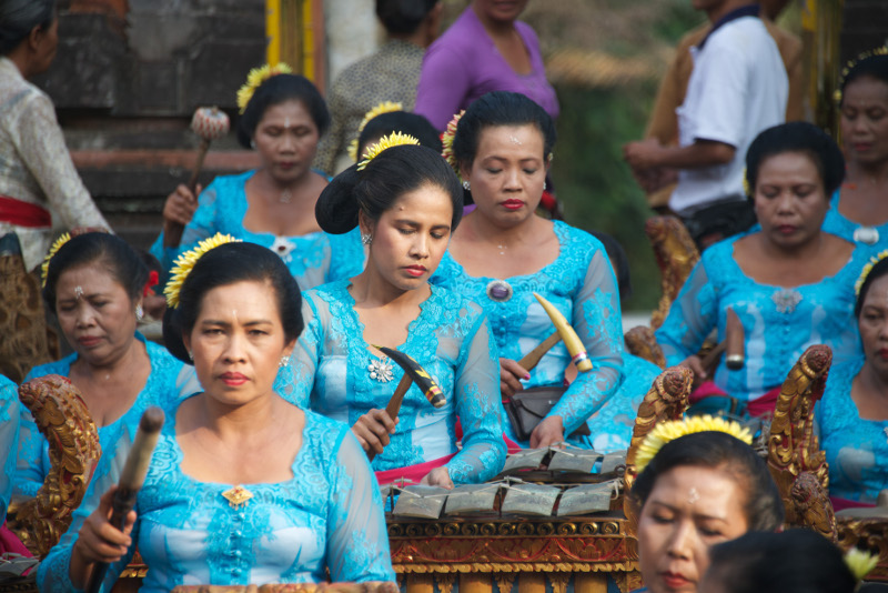 Ladies play traditional instruments at Balinese temple ceremony