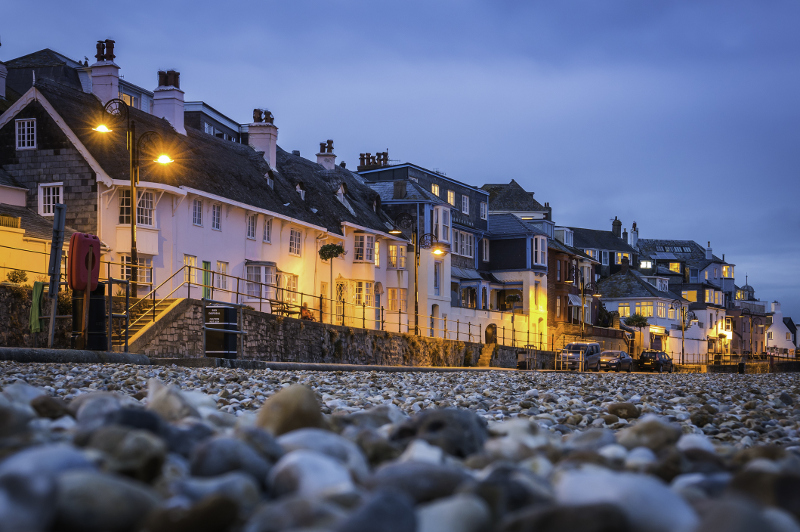 Seaside houses illuminated at night at Lyme Regis