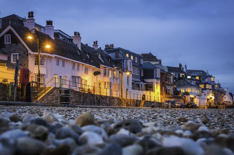 Seaside houses illuminated at night at Lyme Regis