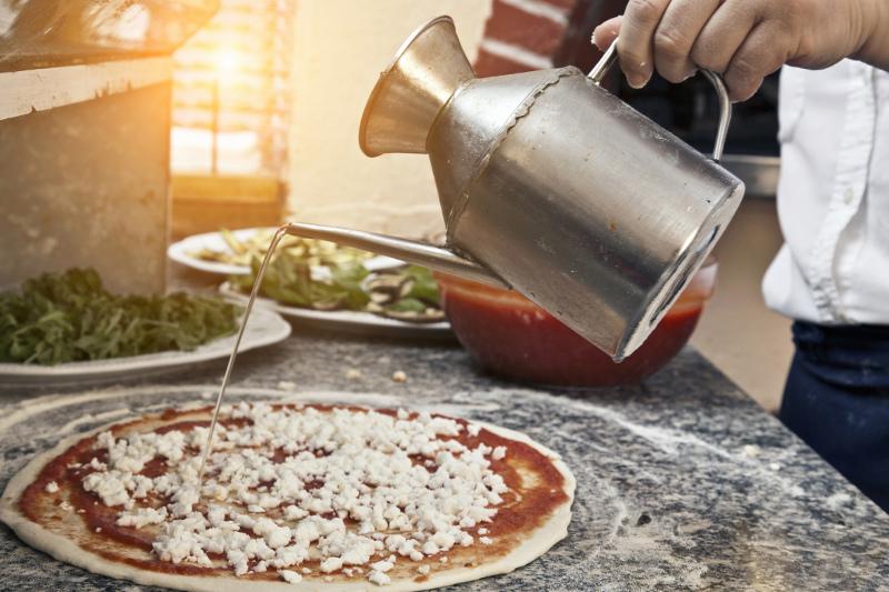 Man makes pizza