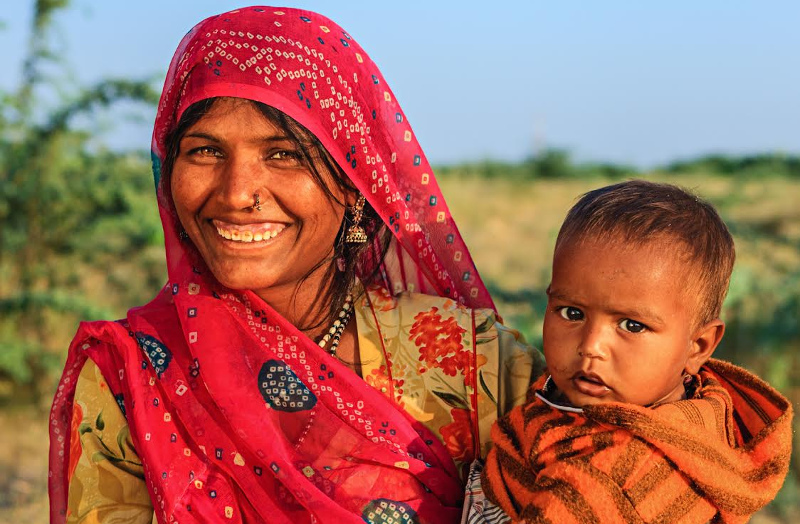 Mother and child in India smile for camera