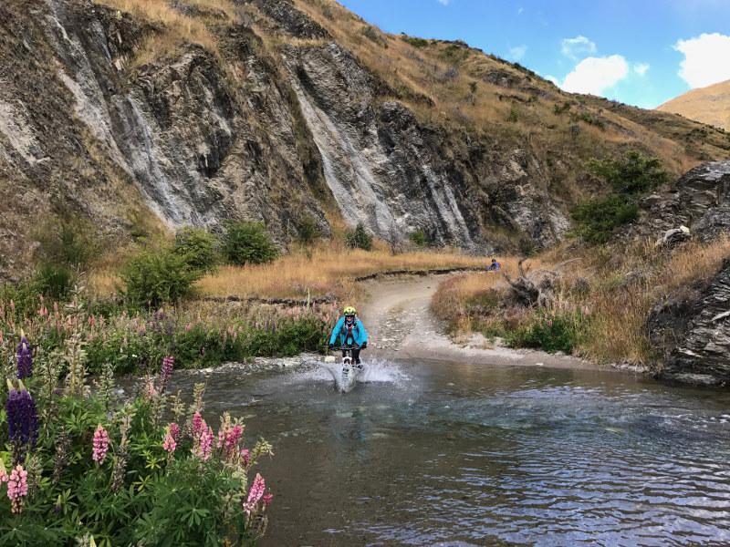 Mountain biking through stream