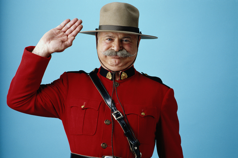 Royal Canadian Mounted Police officer in red ceremonial jacket