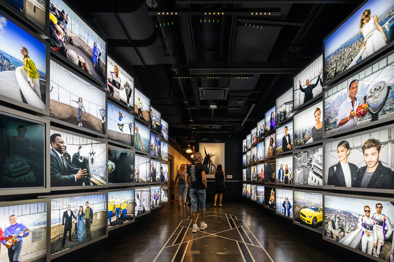 The experience on the second floor includes a gallery of celebrity visitors to the Empire State Building, leading to the elevator to the observation deck. Credit - Mark Wickens for The New York Times