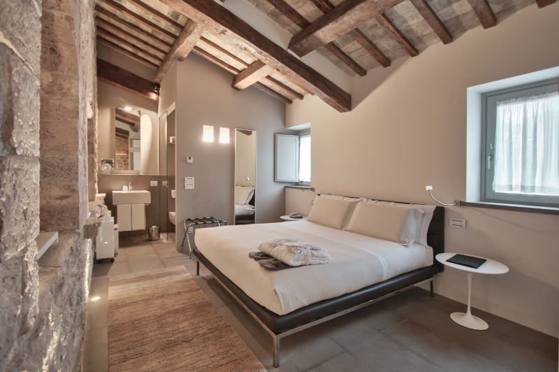 Hotel room with original foundations of monastery