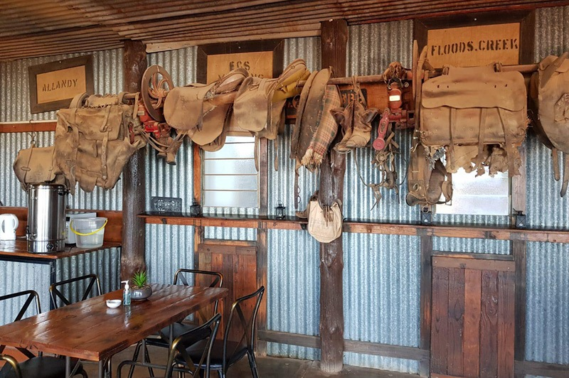 Saddles on display at the Packsaddle Hotel