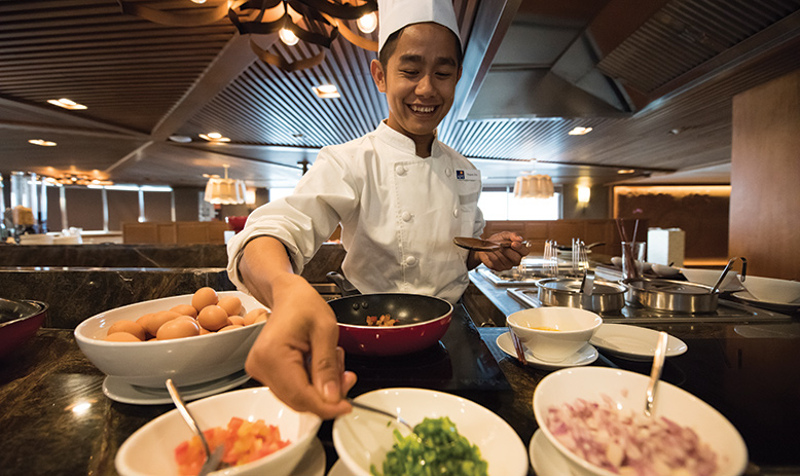 Chef prepares food with fresh ingredients