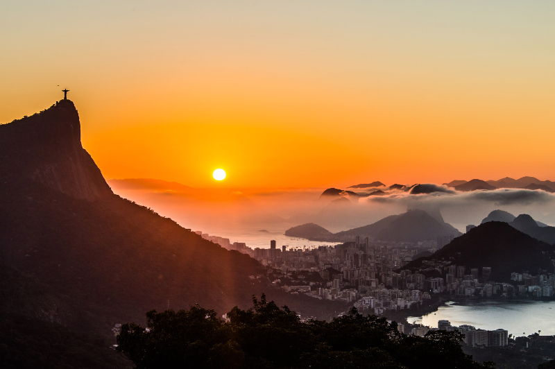 Rio's iconic Christ the Redeemer statue watches over the city at sunrise