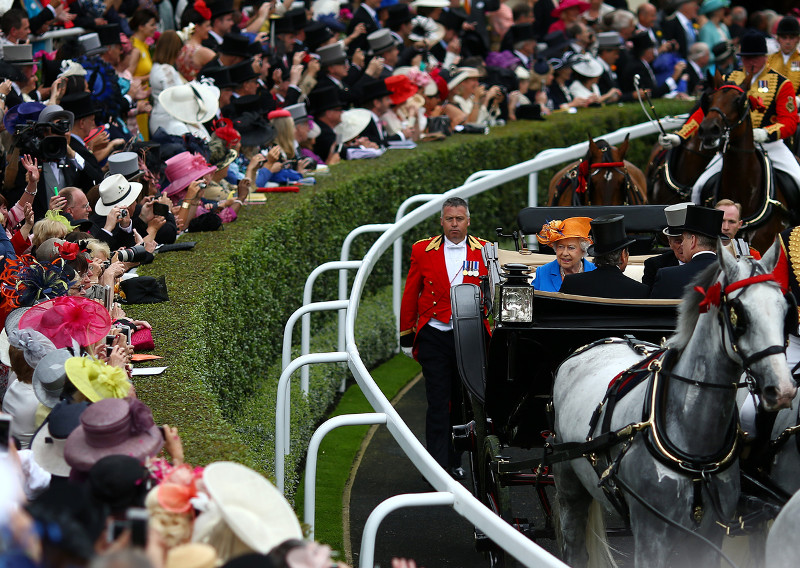 Queen Elizabeth II greets the crowd at races