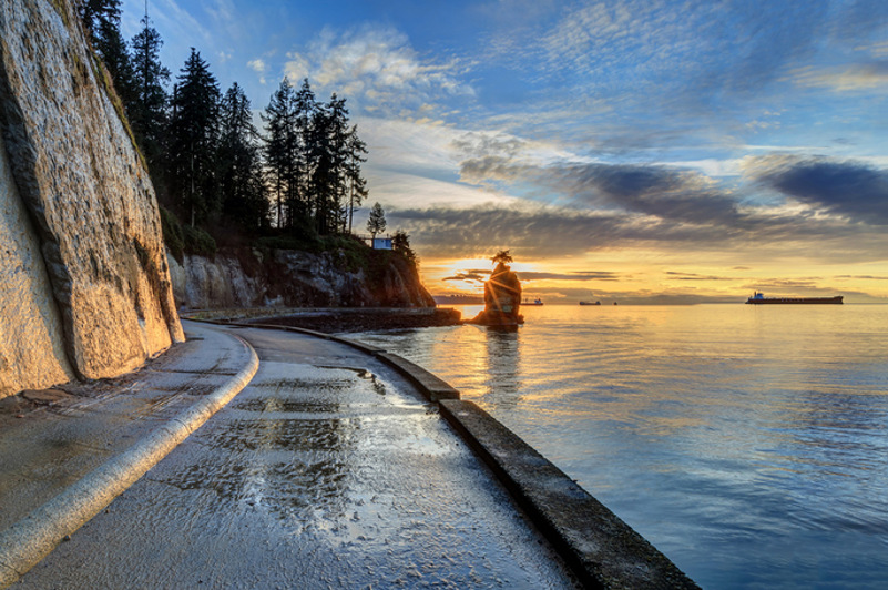 The sea wall in Vancouver, with sun setting in background