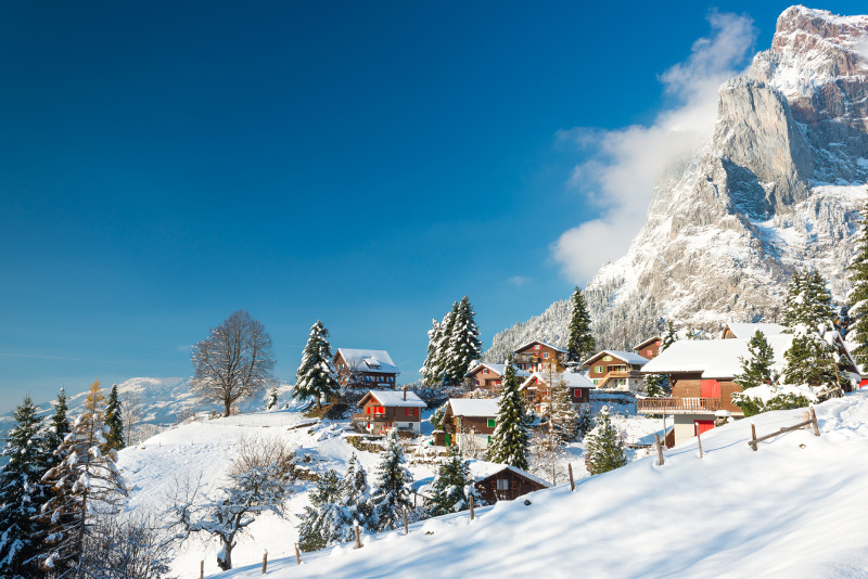 Switzerland winter houses in alps