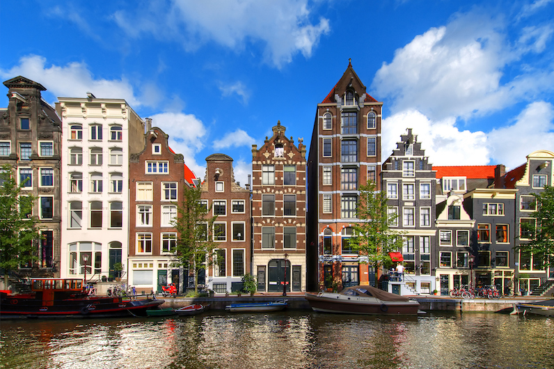 Picturesque narrow houses along the canals of Amsterdam.
