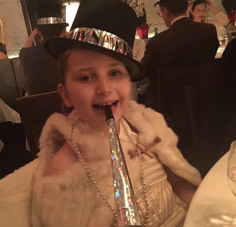 Young girl decked out in NYE finery