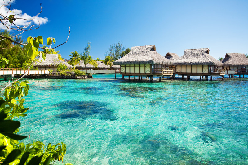 Overwater bungalows in turquoise waters