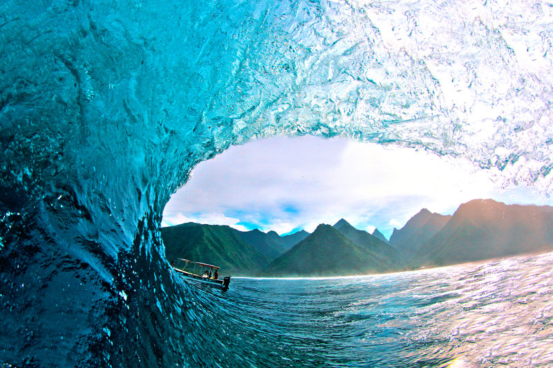 Perfect barrel wave breaks at Teahupoo Beach