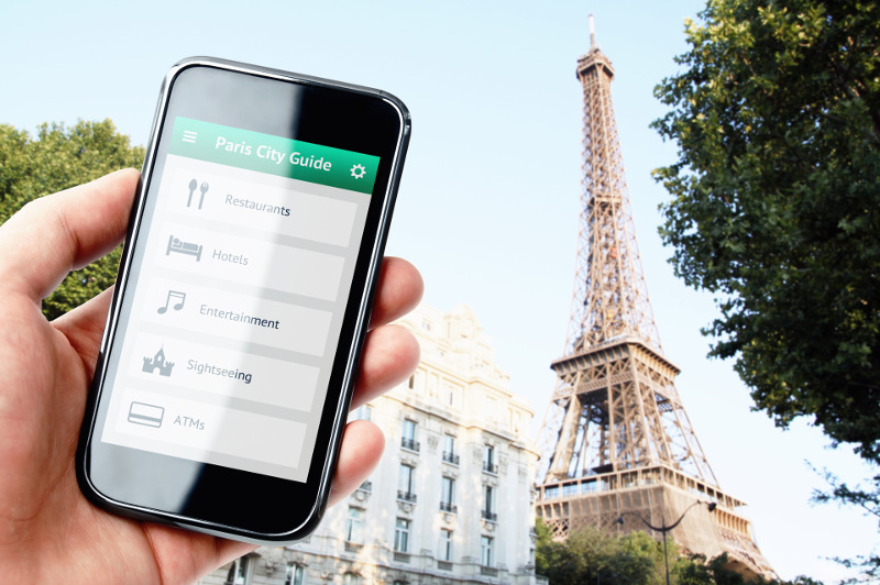 Phone screen with Paris city guide against Eiffel Tower backdrop