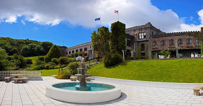Abbeyglen Castle, nestled amongst emerald greenery in Galway