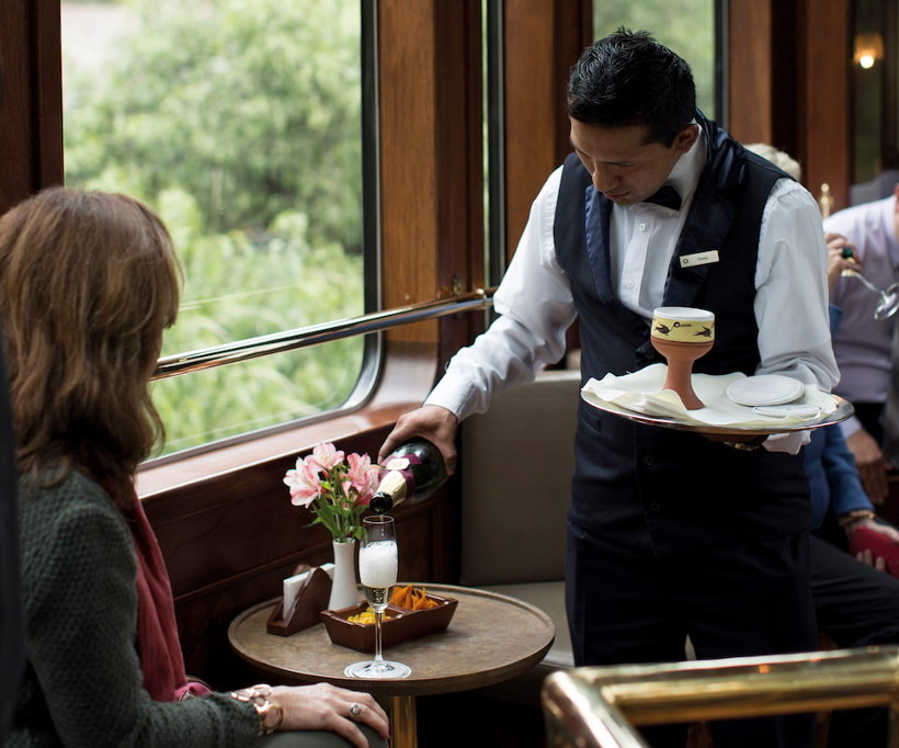 Belmond Hiram Bingham train waiter