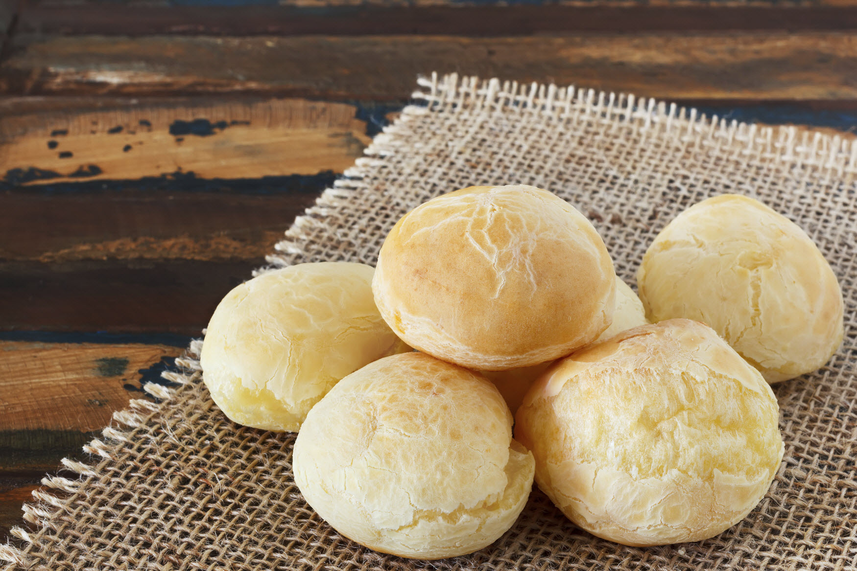 This image: Pao de queijo or cheese bread is a typical Brazilian snack.
