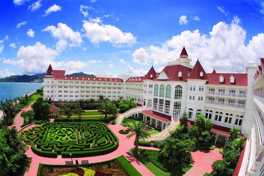 This image: 5-star Hong Kong Disneyland Hotel, set against the coast of the beautiful South China Sea.