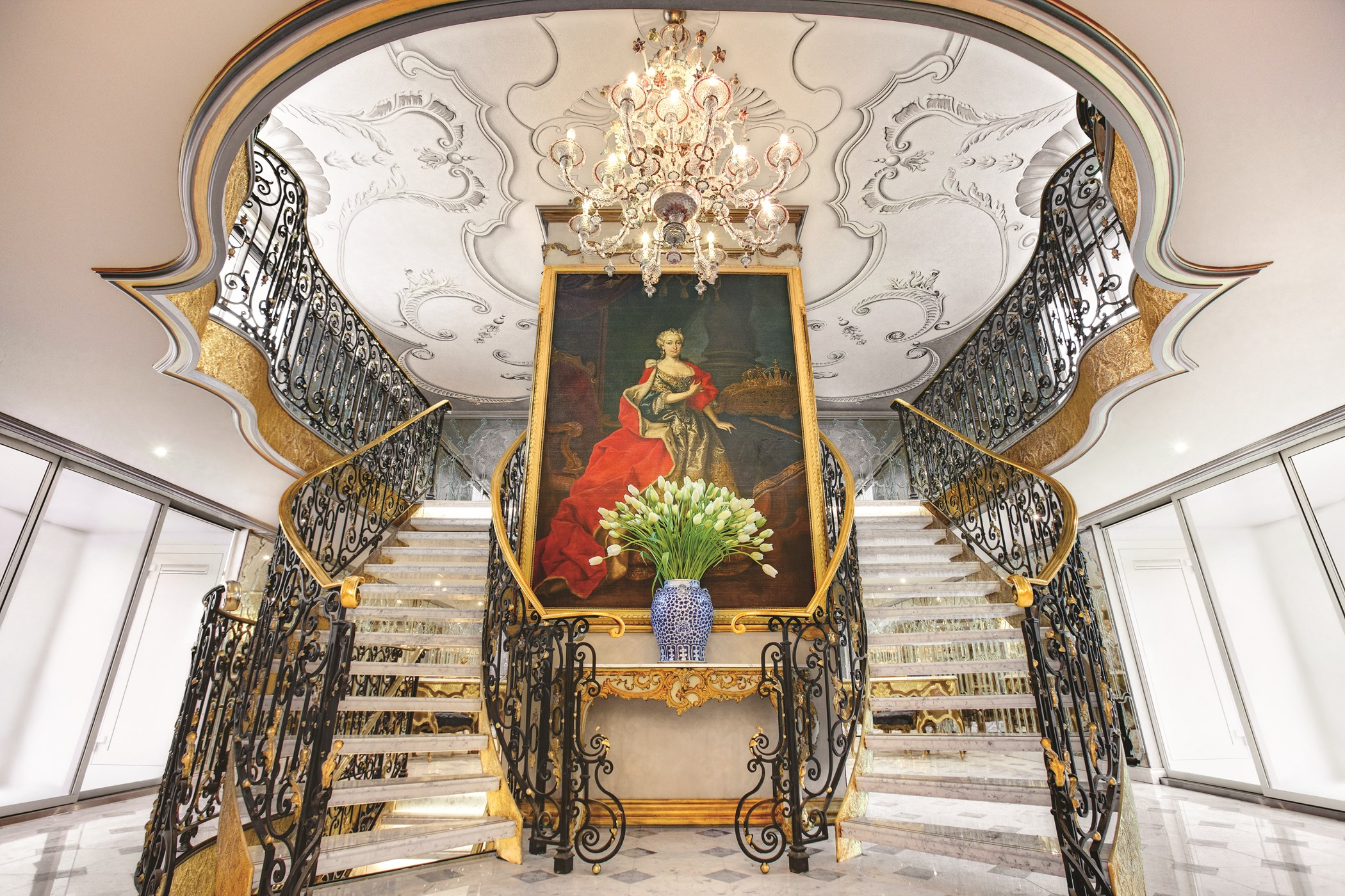 The 3 metre, 18th century oil painting of the Archduchess, purchased at Christie's, presiding over a hand-gilded balustrade in the ship