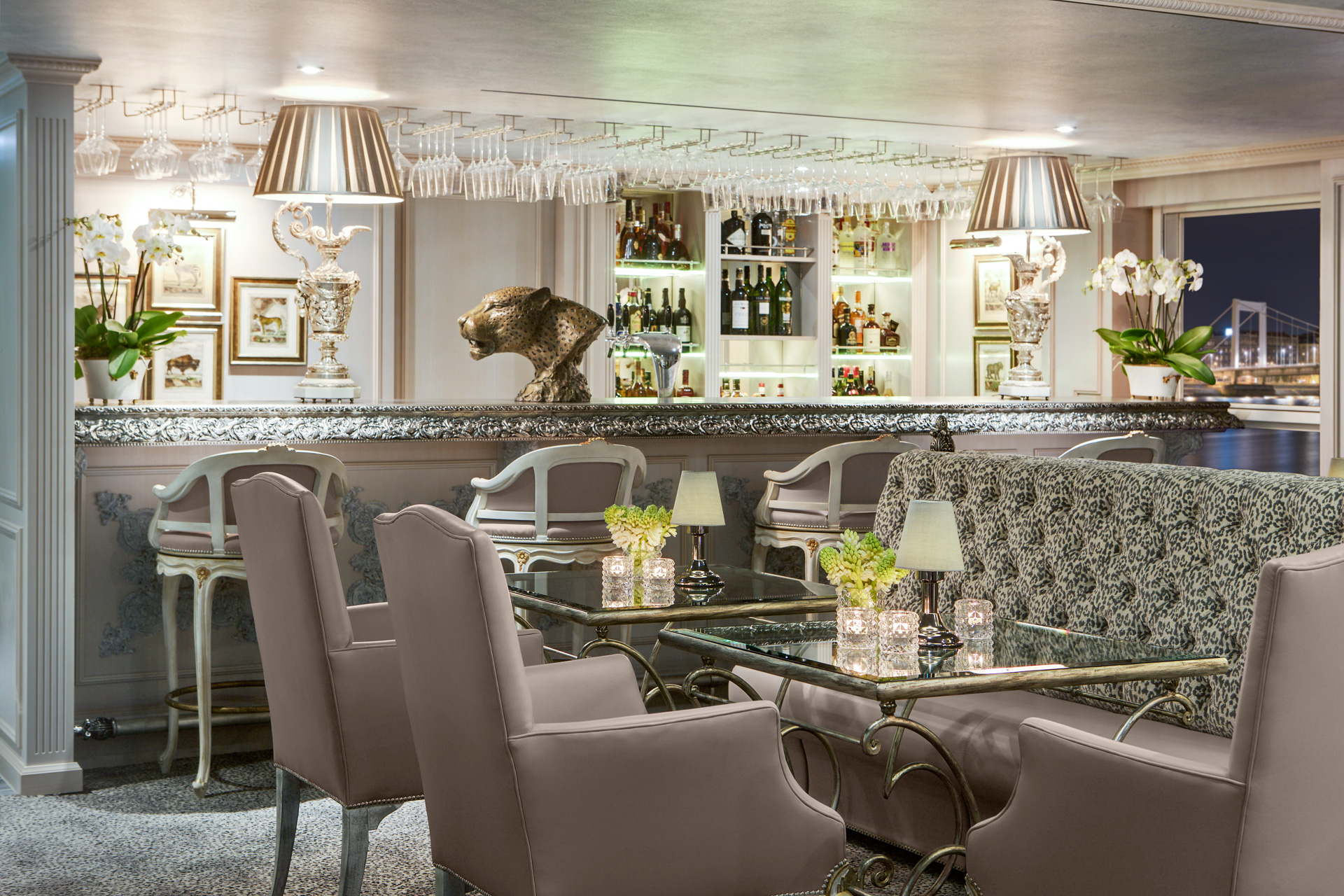 This image: The glamorous Bar de Leopard located at the stern of the ship offers full-service, but lighter lunch options.