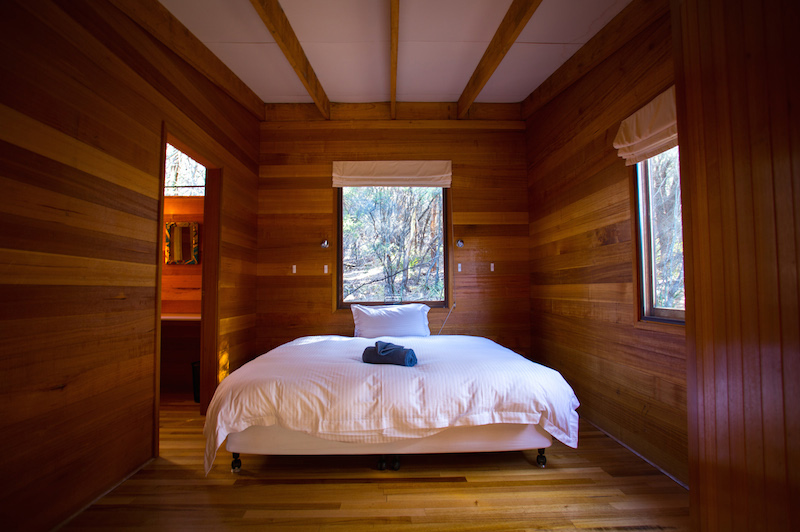 A glimpse inside a room at Friendly Beaches Lodge. Image courtesy of the Great Walks of Australia