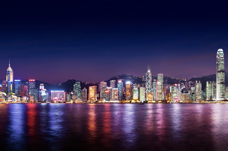 View across Victoria Harbour from Kowloon by night. Image: Hong Kong Tourism Board.