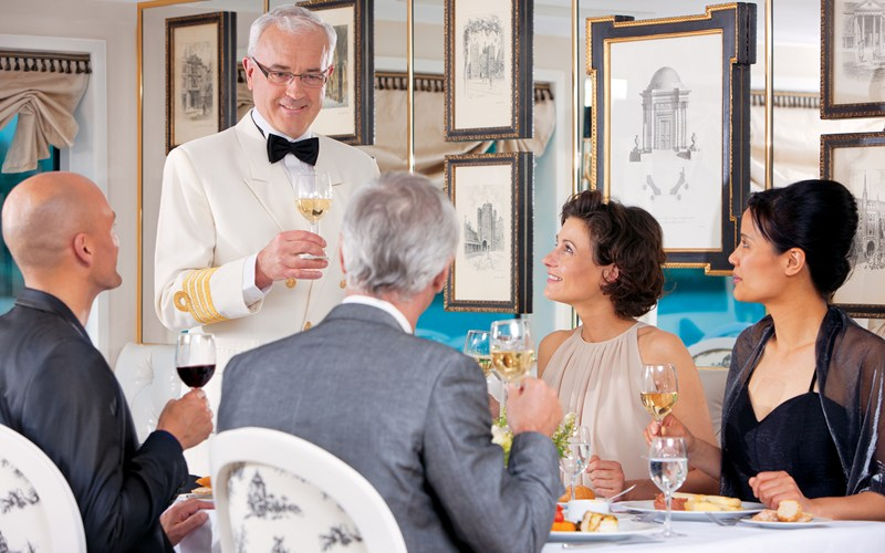 Wine sommelier on board the River Baroness. Image courtesy of Uniworld.
