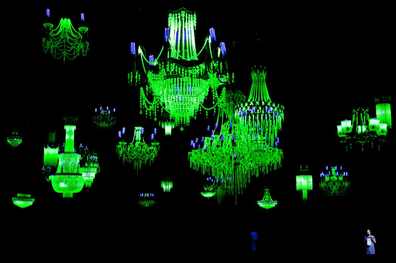 Ken + Julia Yonetani Crystal Palace: The Great Exhibition of the Works of Industry of all Nuclear Nations 2012-13. Uranium glass, metal, UV lighting. Image courtesy of the artists.