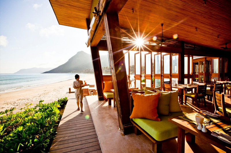 Beachside suites and villas are crafted from reclaimed teak. Image: Six Senses Con Dao.