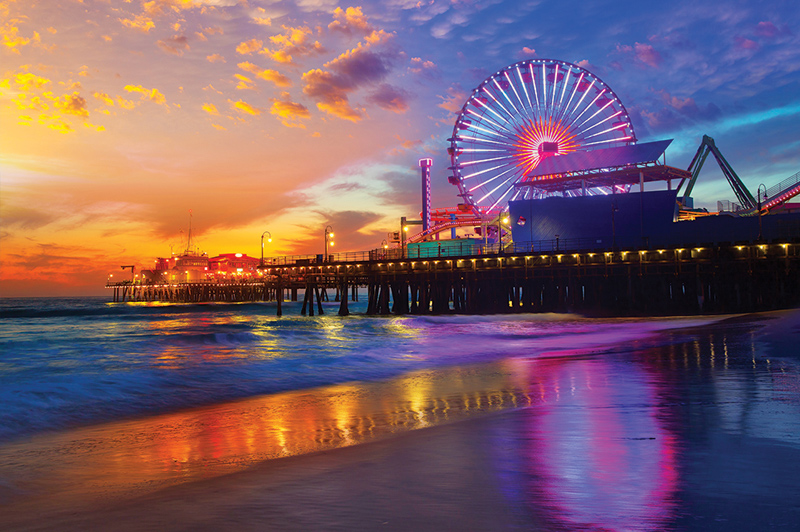 The sun sets on another day in L.A. behind the Santa Monica Pier. Image: Getty