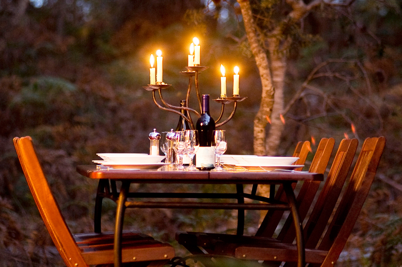 Candle lit dinner at one of the tented camps. Image courtesy of The Maria Island Walk.