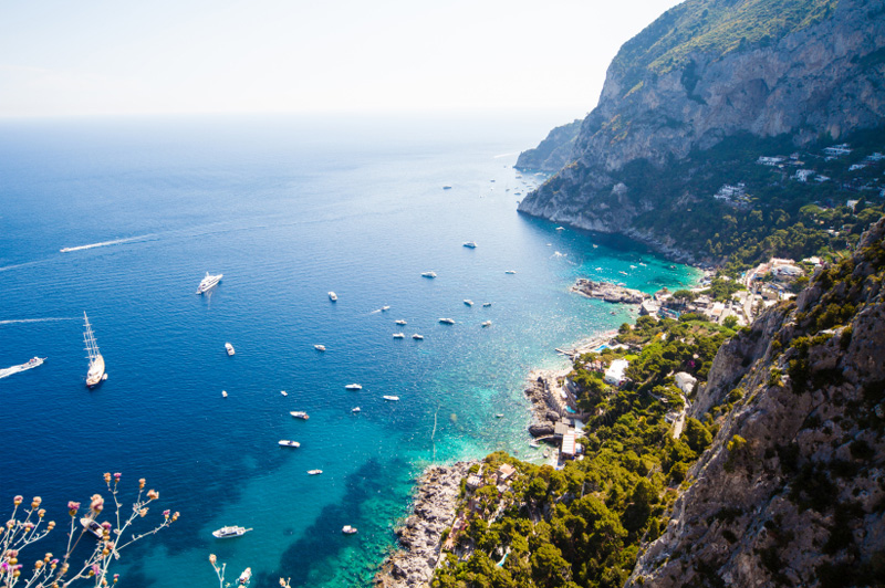 Looking down at the coastline of Capri. Image: Getty