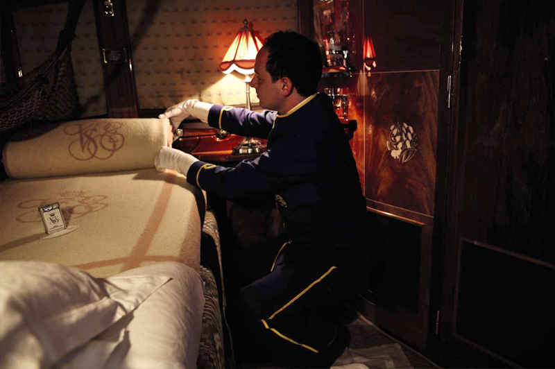 A Belmond staff member adds the finishing touches as part of the turndown service