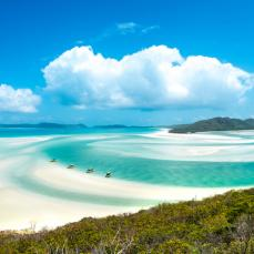 Clear blue water and white sandy beach