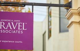 First Travel Associates sign