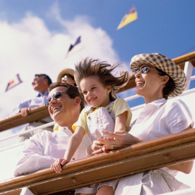 Parents with their daughter on the deck of a cruise ship