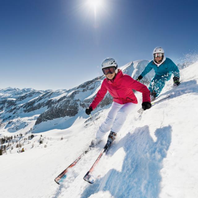 Couple skiing on mountain